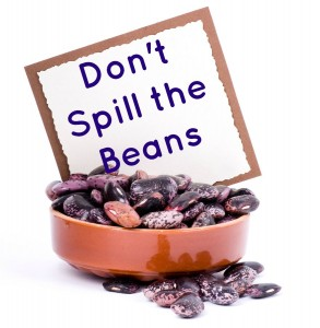 A bowl of beans with a banner add on a white background